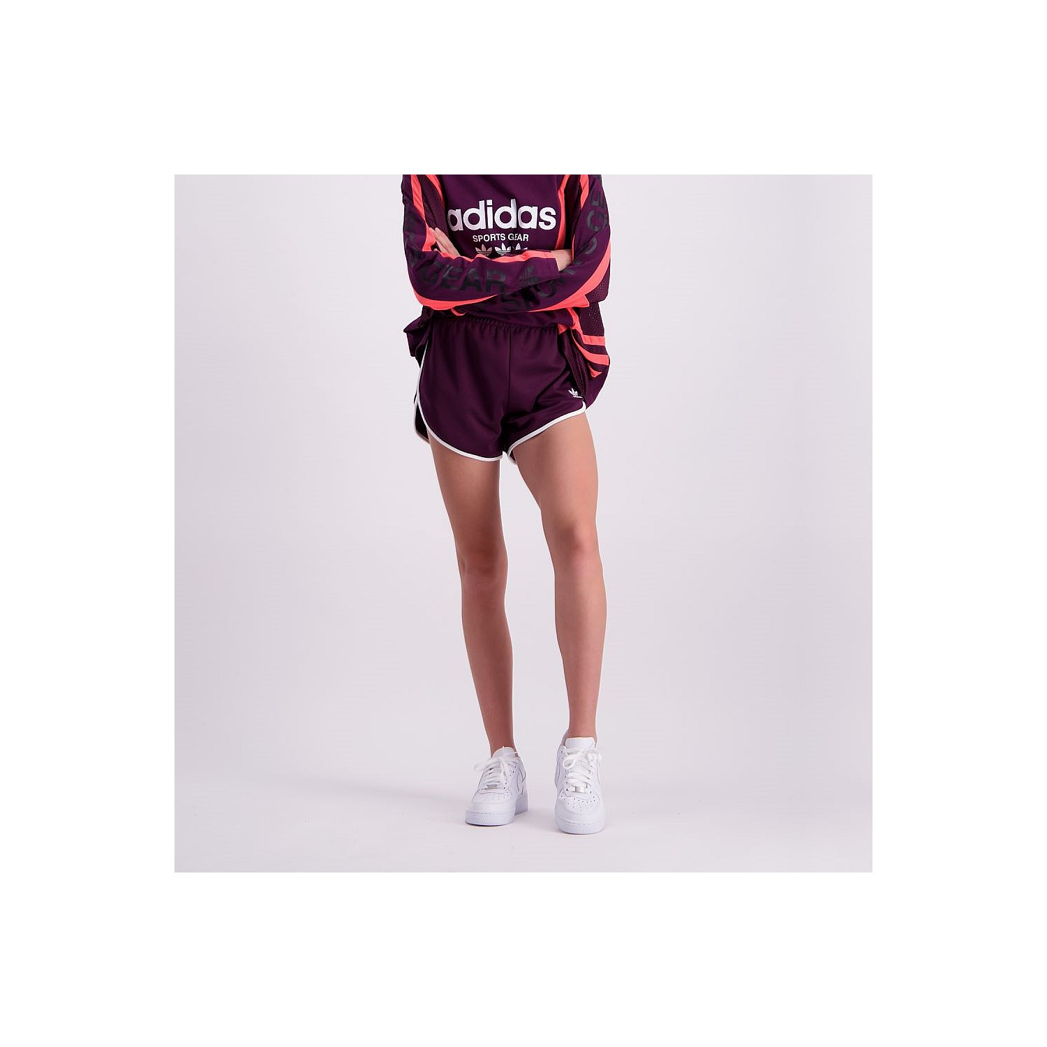 773078697b72 These chic shorts are made of a soft cotton blend and boast an iconic adidas  track suit colour. A small contrast embroidered Trefoil logo finishes the  look.